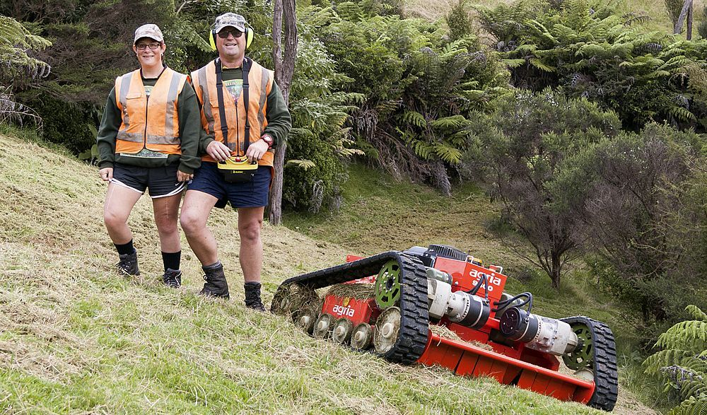 All Terrain Services Team with mower